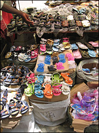 Local marchants are having problems competing with Chinese merchants who offer goods like these shoes at low prices