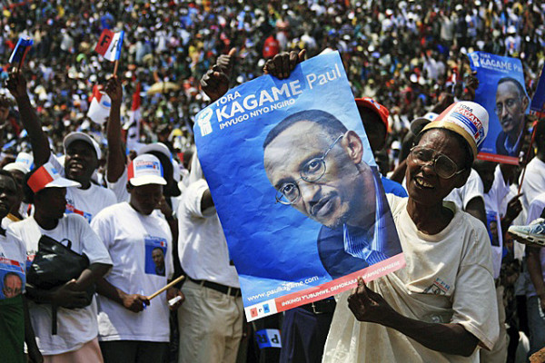 A supporter of the ruling RPF holds a poster of incumbent President Kagame at a rally ahead of next week's presidential election in Byumba